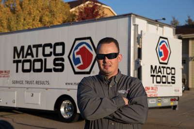 Automotive franchise owner standing in front of their mobile tool truck proudly showing off their franchise investment.